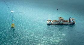 Wind build-up: turbine and service vessel, part of offshore wind's continued surge (Photo: GE)