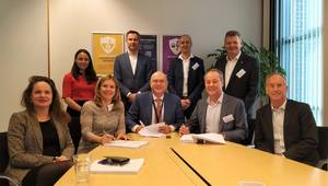 Stork's Carla Rodenburg together with Lex de Groot, Neptune Energy, and Worley's Jim Lenton sign a four-year engineering services agreement for Dutch assets in the North Sea. (L to R with pens in hand) (Photo: Business Wire)