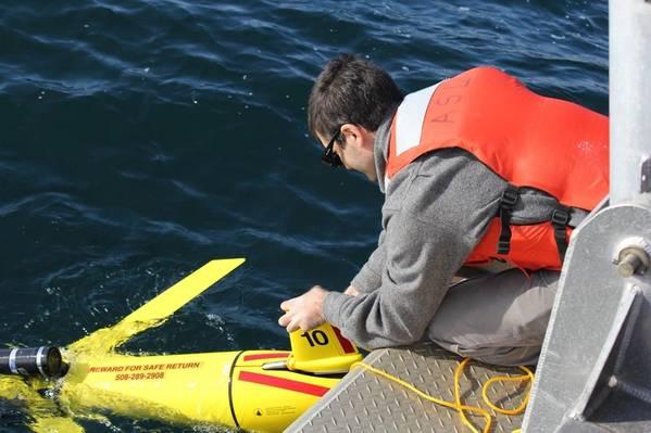 Autonomous glider being deployed. Photo: NOAA Fisheries
