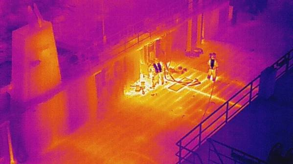 Chemical suites and high temperatures: Norwegian firefighters (seen on deck and via thermal imaging drone) battled overnight to contain a battery room fire aboard a ferry that sent 12 of them to hospital for chemical exposure (Photo: City of Bergen Fire Department)
