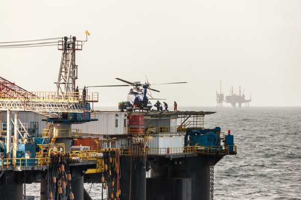 Illustration; Workers boarding helicopters on an offshore installation in the North Sea.