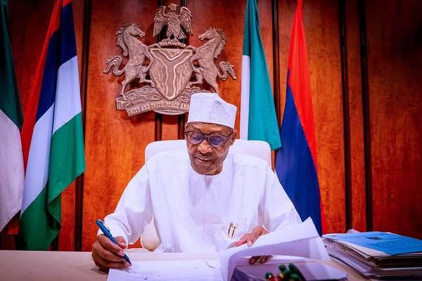 Nigerian President Muhammadu Buhari signs into law an oil overhaul bill - Credit: Nigerian Government