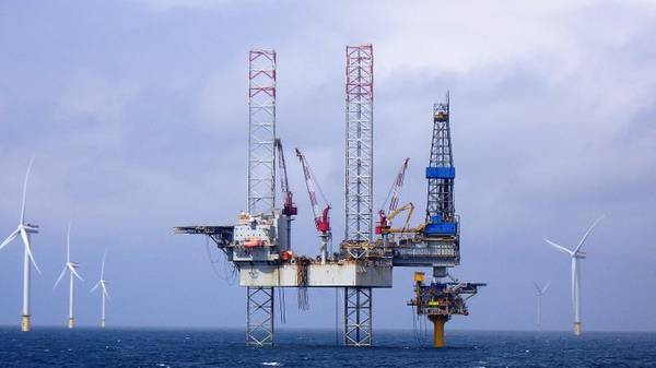 The Noble Hans Deul rig on location over the Blythe platform, with Dudgeon wind farm in the background. (Photo: IOG)