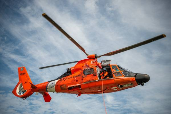 File photo: an MH-65 Dolphin helicopter aircrew from Coast Guard Air Station New Orleans (U.S. Coast Guard photo by Travis Magee)