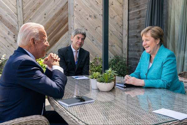 File photo: President Joe Biden meets for a brief pull-aside meeting with German Chancellor Angela Merkel during the G7 Summit at the Carbis Bay Hotel and Estate on Saturday, June 12, 2021, in St. Ives, Cornwall, England. (Official White House Photo by Adam Schultz)
