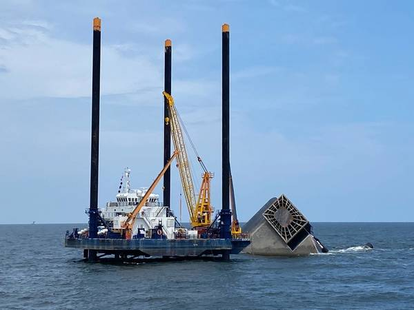 Responders conduct salvage and pollution response operations in the wake of the fatal Seacor Power capsizing. (Photo: Brendan Freeman / U.S. Coast Guard)