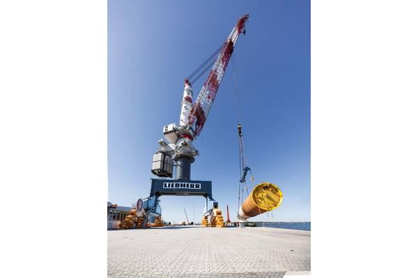 "Liebherr TCC 78000 heavy-duty crane loads 72 monopiles for the largest Danish offshore wind farm ""Kriegers Flak"" / Image Credit: Liebherr"